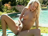 This scene features Eurobabe Jana Cova.  This petite Czech plays with her beautiful pussy out by the pool until she is fully satisfied.