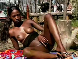 In this scene, India does a striptease outdoors.  She plays all by herself, rubbing her hairy black vag to get herself off.