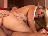 Lisa De Marco gets with her stunt cock on a couch for this scene.  She pulls out his cock to suck on, and then she gets her holes licked.  Her pink pussy is pounded until she gets a huge load dropped all over her face and in her mouth.
