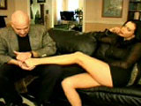 Angelica Sin, a hot busty brunette, is giving this big johnson some good foot play. She gets much enjoyment out of running his hard cock between the soles of her feet.