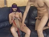 Stephanie is a slutty slave all tied up and blindfolded on the couch.  Her keeper comes over and shoves his cock in her face, and that when the fun begins.  She sucks his cock and he eats her shaved slot.  They fuck until the guy blows his wad on Stephanies tongue and panties.