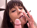 She doesn't care what she wraps her lips around, as long as she can suck it. This mouth slut smokes and sucks, and smokes and sucks some more in this sultry, POV scene that includes a lot of cigarettes and a slobbery POV blowjob. She uses her lips and hands to get this guy off, and she's so tale