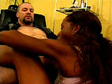 In this scene, Violet Demarco is relaxing her man, giving him a light massage in a chair.  She works her way down and pulls his cock out, and then strokes it with her feet before sucking on it.  