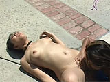 Lana Croft is enjoying a nice afternoon at the pool.  She masturbates while sunbathing and then takes a dip.  Her friend Melanie Scott stops by and has some time to kill before going to work.  These two munch each other's boxes poolside until Melanie has to leave.
