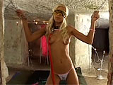 In this scene, Nicky Blonde is tied up in a basement with some construction going on.  One guy comes over to untie her and have his way with her.  She is quick to suck on his large dick, and she gets it stuffed in her bald twat repeatedly until getting a mouthful.