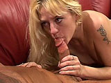 A guy walks in to find his woman, Daryn Lee, sleeping on the couch.  She wakes up and immediately gets to work on his cock.  Daryn expertly uses her mouth and hand to get a big load dumped all over her face.