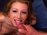 A gorgeous redhead is all smiles as she struts around in a red getup, and then takes a big meaty cock in her mouth. As she slobs and sucks, she stares up at her costar, flirting and giggling, loving every inch of sausage being rammed into her sweet face. Finally she grins and opens wide while he jer