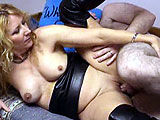 This mature and amateur chick dressed in leather goes by Bad Annie.  The hairy geek licks and fingers her pussy, and then she sucks on his little dick.  They fuck a bit and in the end, Annie strokes him off on to her face.