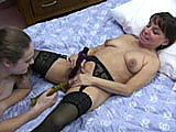 Vixen and Danni are together again.  This time they are on a bed.  They use vibrators and dildos to aid in the pleasuring of each other.