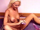This amateur scene pairs up Angelina Hart with midget girl Vixen.  They get undressed and Angelina works a dildo and vibrator on Vixen.  Angelina gets her turn with a vibrator while her clit is diddled.