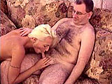 Angelina Hart was convinced to give a hairy geek a blowjob.  She works her magic mouth on his little dick until he pops off in her mouth and she swallows his load.
