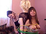 In this scene, Madalyn ties up Ava and Vixen.  Once she has them secure with all the ropes, she licks their tits and twats.