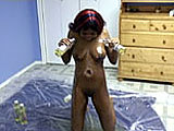 This scene has ReVay by herself for a messy scene.  She gets naked on a sheet of plastic and oils herself up with multiple bottles of vegetable oil.