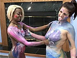 In this scene, Lavender and Fiona play with paint.  They rub different colored paints all over their naked bodies until they are almost completely covered.