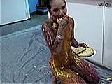 In this scene, Miko Starr is naked in the kitchen with multiple pies and ice cream.  She rubs them all over her body and eats a lot of it like she has been famished for days.  Chocolate syrup is poured on top to complete the tasty treat.