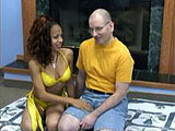 This scene has Dolly Catholic together with the bald geek.  She sucks him to completion and he nuts on her tits.
