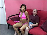 This scene has Dolly Catholic paired up with baldy.  She gives him a lap dance, grinding on his crotch, and strips out of her pink bikini.  When he is ready, she pulls out his dick and plays with it, sucking him to completion.  He nuts in her mouth and she spits it back out on to his dick.