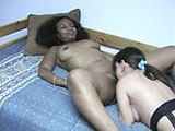 In this scene, Cinnamon Delight gets with Vixen the midget.  Vixen licks that fuzzy black pussy and then they get in to a 69 so both can lap at the lips.  Cinnamon licks Vixens vag and they end with a tongue kiss.