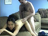 Colette is a sexy little Asian amateur.  This little whore will fuck anything.  In this scene she sucks and fucks a hairy geek until he blows his load in the condom.