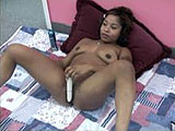 Stephanie is the ebony amateur featured in this scene.  She is on the floor with a vibrator pleasuring herself.  After rubbing the toy on her body and buzzing her clit, she stuffs it inside her shaved slit to finish the job.