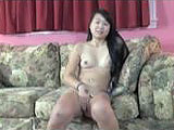 This shy Asian is Jaylynn.  She is a petite college chick of Chinese descent and she only likes girls.  This is her casting video for work in the amateur porn biz.  She shows off her body, piercings, and her tattoos for the camera.