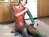 In this scene, Jaylynn is on a sheet of plastic in the kitchen.  She covers her naked body in different colored paints for the camera.