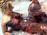 Crystal Frost gets with the hairy geek for a messy.  They get naked on the floor on a sheet of plastic, where geek boy proceeds to rub chocolate, blueberry, and tapioca pudding all over her body.  The idiot even gets it in her coochie.  Hope she douches well after the scene.  Crystal then rubs some 