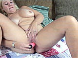 Liisa is a voluptuous blonde that is here to play for the camera.  She shows off her pierced nips and clit, and then gets down to business with her vibrator.  She works it in and out of her bald clam until she gets herself off.