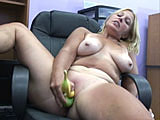 In this scene, Liisa is in an office chair and plays with her lunch.  She stuffs bananas in her pussy and even manages to get two in at the same time.