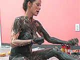 Leeanna plays with food in this messy scene.  She loads up her body with ice cream and corn syrup, trying to cover all of her naked body.  She licks the tasty treat from her toes and tops herself off with candy corn, turning herself into a Halloween treat.