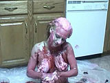 This amateur scene features Anna.  She plays in the kitchen with ice cream, syrup, and toppings; making herself into a big, naked sundae.  Anna lets you watch her shower off at the end.