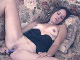 Maria Maines plays by herself in this scene.  She rubs a vibrator on her button and works it in and out of her pink pussy.  After she cums on it, she gives it a little taste.