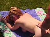 A slutty redhead in a schoolgirl skirt yaps about loving meaty cocks in her mouth, and sure enough, she sees a dorky guy outside in the yard. She crawls across the grass to him, and immediately puts his thick dick between her lips. She loves the feeling of it sliding in and out, but he wants some of