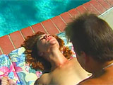 Sonja Redd wanted to be a jockey when she grew up.  Well that obviously didn't work out.  So instead of riding horses, she rides cock on film.  In this scene, Sonja sucks and fucks a guy out by the pool.  Watch this natural redhead work that dick until it spews all over her chin.