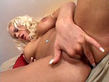 Stacy Silver is a sexy blonde with big tits.  She does a hot tease, masturbating and fingering her shaved pussy.  Two guys enter the scene and abuse all of her holes.  They stuff their cocks in every orifice and give her plenty of DP.  Both of them blow their loads in her mouth and on her face.