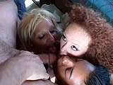A redhead, a blonde, a brunette, and a sexy black girl all get fucked in the back of an RV by a group of guys. All of the guys plow their erections down each of the sluts' throats.  They all break off into couples where hardcore fucking ensues, some of the whores even get double penetrated.