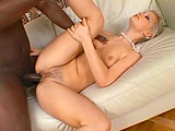 Maya Gold is a hot, platinum blonde Czech girl who's about to learn the hard way that the rumors she's heard about African men are true.  She does her best to slob his enormous knob and he gets so horned up by her tight body and slutty antics, that he starts fingering her ass while using his pol