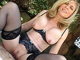 What starts as a simple interview abruptly turns into a demonstration from one of the porn industry's most seasoned and celebrated, mature stars.  Nina Hartley gets the cameraman's pants off and examines his cock thoroughly with her hands and mouth.  She knows all the tricks to get him rock hard