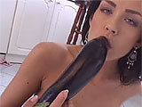 This sexy brunette gets herself worked up with an eggplant in the kitchen.  She rubs it all over her body and strips down naked on the kitchen floor.  Watch her rub it on her bald box and finger herself to orgasm.