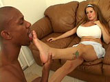 Here is another foot worship scene.  This one has Summer Sinn and her massively large cans, mostly lying on the leather sofa.  This black guy worships her toes and feet, and she sucks on his cock.  She puts those huge tits to good use and gives him a nice tit fucking.  He ends by jerking off onto he