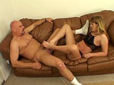 This foot worship scene has Krystal on the leather couch wearing black stockings, panties, and heels.  Her feet are worshiped while still wearing the stockings, and then she sucks Rod Fontanas cock.  He pulls off the stockings and sucks her toes while she blows and strokes him.  A footjob is give