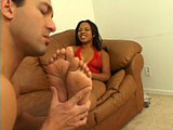 Kandi Kream has very ticklish feet and toes, but loves Dino Bravo licking and sucking them.  She stokes his cock with her feet, and then gives him a knob shine until he blows jam on her feet.