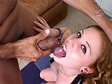 Cherry Poppens is a redheaded ass licker with her face buried between a guy's hairy cheeks.  She deepthroats cock and we get to see that her carpet matches the drapes.  The guy shoots his load on her tongue and she swallows it down.