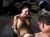 Gia, a really cute brunette, gets her pussy thoroughly tongued. Then, she hops on the guy's large cock, and takes it for a ride until he drops his load on her little titty.