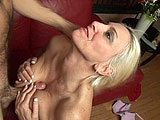 Kayla is tired of her man not giving her any attention, so she walks in the rooms and starts giving him a blowjob while he's watching a game.  This mature blonde takes his cock deep and throws in some titty fucking to boot.  Her man licks her pussy before she mounts up to ride him.  Kayla bounces