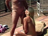 A mature couple chats on the deck. The old dude is a lawyer, and his hot girlfriend has long blonde hair, huge tits and a sassy mouth. They get naked by the pool and he eats her pussy through her sheer white panties. Then she blows him, but this codger has no problems getting hard. He's a horny ol