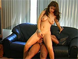 Afer some quick photos, Tye is all ready to fuck.  She gets with her black stud on the couch, sucking his cock deep.  Then its her turn, and she gets her hair vag eaten out.  A round of doggy, reverse cowgirl, and regular cowgirl, and Tye is waiting with mouth wide open for spooge.