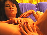 Tara is a bit of an exhibitionist and is aturned on by the thought of a camera on her.  She gets together with Candy Roxxx in this scene.  These two get it on on the couch, licking tits and twats.  They shove toys in and out of their pink pussies unitl they are spent.