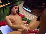 For this scene, Claudia and Anita get together poolside for some fun in the sun.  They munch each other's balr pussies and scissor with a double ended dildo.