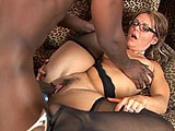 Kelly Leigh shoves a butt plug in her ass and keeps it there while sucking and fucking big black cock.  It pops out from time to time, but stays in place through most of the scene until the guy replaces it with his massive member.  Kelly gets a load of spooge dropped in her mouth in the end.